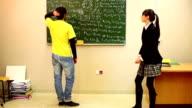 Boy looking at math problem on blackboard