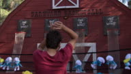 Boy makes a shot playing Barnyard Basketball at Knott's Berry Farm theme park, raises arms in celebration