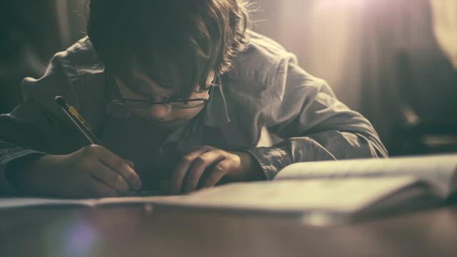 Boy making his homework
