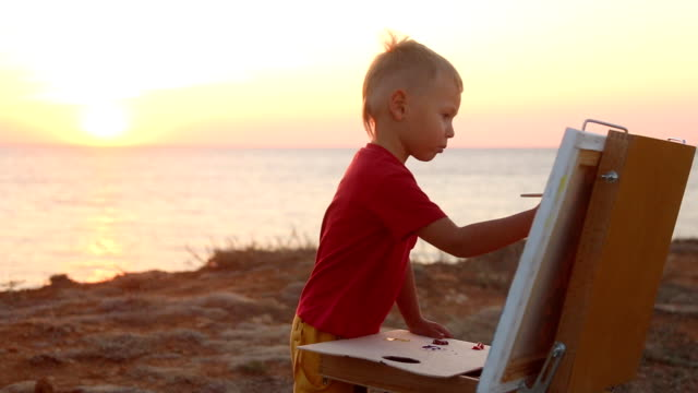 Boy paints