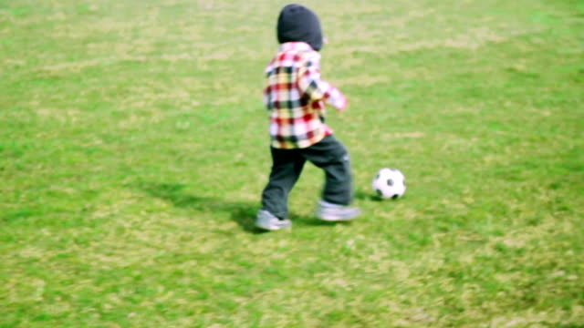 Boy plaing with soccer ball