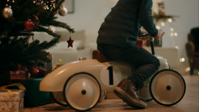 Boy plaing with toy car