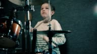 Boy playing drums