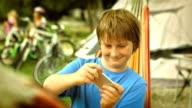 Boy Playing Handheld Video Game