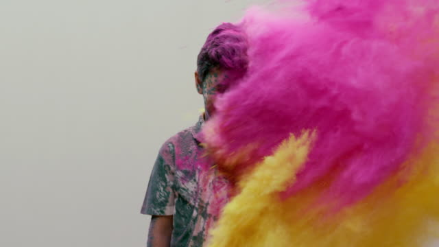 Boy playing holi festival