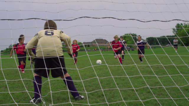 WS PAN Boy playing soccer, scoring a goal / Rockford, Illinois, USA