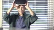 Boy playing virtual reality game