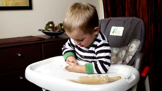 Boy playing with dough