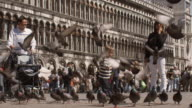 SLO MO, MS, Boy (2-3) playing with pigeons on Saint Mark's Square, Venice, Italy