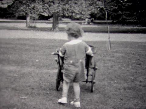 1933 boy pushing baby carriage