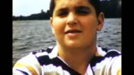 1964 Boy Rowing at Summer Camp
