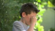 Boy rubbing his eyes