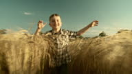 HD SLOW-MOTION: Boy Running In Wheat