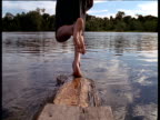 Boy runs and dives into Amazon river and scares shoal of fish