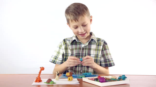 Boy sculpts from plasticine figurines