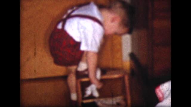 1957 boy shines shoes with shoe shine kit