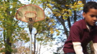 MS Boy (8-9) shoots basketball and scores / Montclair, New Jersey, USA
