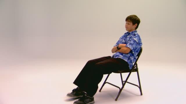 Boy sitting, bored