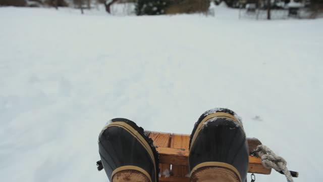 CU POV Boy (6-7) sledding downhill / Richmond, Virginia, USA