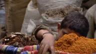 CU, Boy (8-9) smelling herbs on street market, Cairo, Egypt