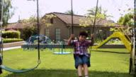 WS Boy swinging