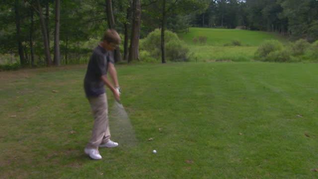 Boy takes practice swings