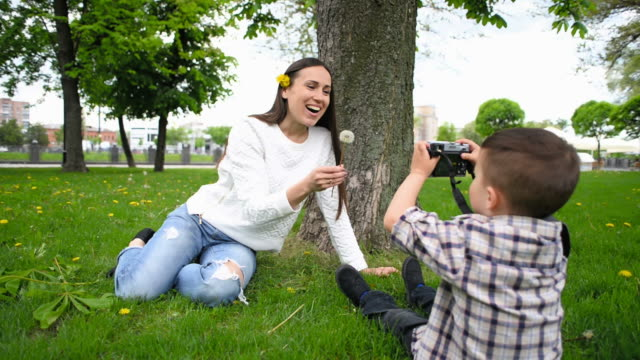boy taking photo his mother