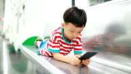 Boy Using Smart Phone in the metro