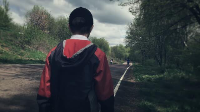 Boy walking alone in the park