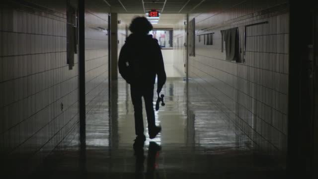 WS Boy (12-13) walking along school corridor, Cazenovia, New York, USA