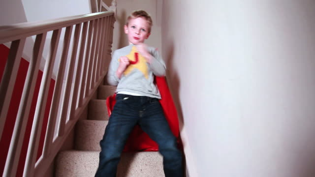 Boy wearing cape
