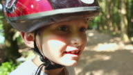 CU Boy (8-9) wearing cycling helmet and smiling / Squamish, British Columbia, Canada