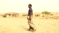 Boy who went through teeth ritual walking through village