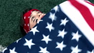 boy with an American flag thinking about winning