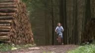 WS PAN Boy with bicycle at forest / Tawern, Rhineland-Palatinate, Germany