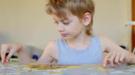 boy with jigsaw puzzles