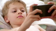 boy with mobile phone, close up