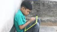 Boy writing on slate