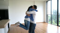Boyfriend covering partners eyes and surprising her with a new home