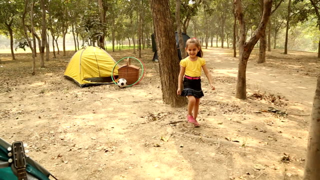 Boys and girl playing hide and seek game in the park, Delhi, India
