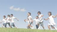 Boys and girls running jumping