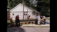 MONTAGE Boys building boats for outward bound in United Kingdom