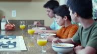 MS Boys (12-17) eating cereal in kitchen / Renton, Washington, USA