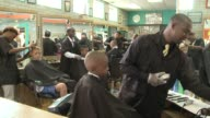 Boys Getting Their Hair Cut In Barber Shop on August 24 2013 in Chicago Illinois