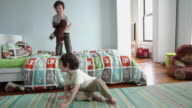 WS Boys (2-5 years) jumping on bed in bedroom / Brooklyn, New York City, USA