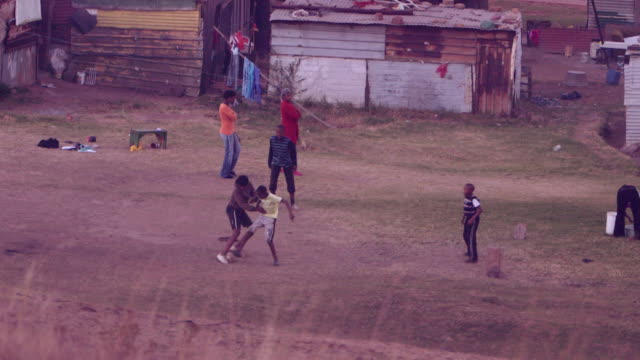 Boys playing football in a South African village