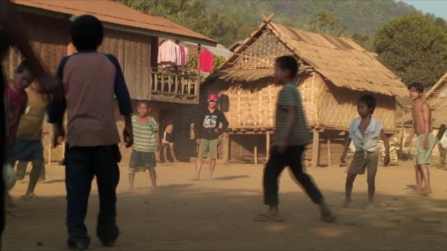 WS ZO Boys playing soccer in village, Pak Ou Villages, Laos