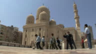 WS LA Boys playing soccer on esplanade in front of Abu al Abbas al Mursi Mosque, Alexandria, Egypt