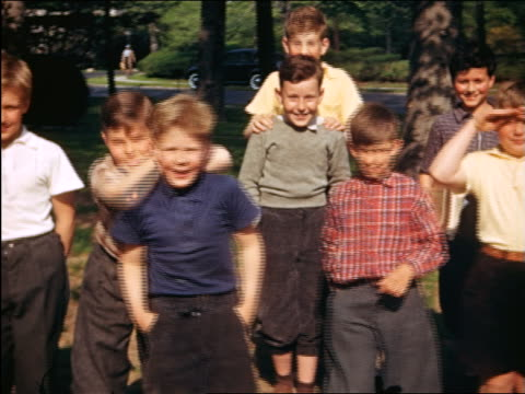 1940 boys pose for camera outdoors / some make faces + monkey around / Maplewood, NJ / home movie