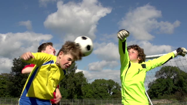 Boys scoring three goals in Kid's Soccer / Football match